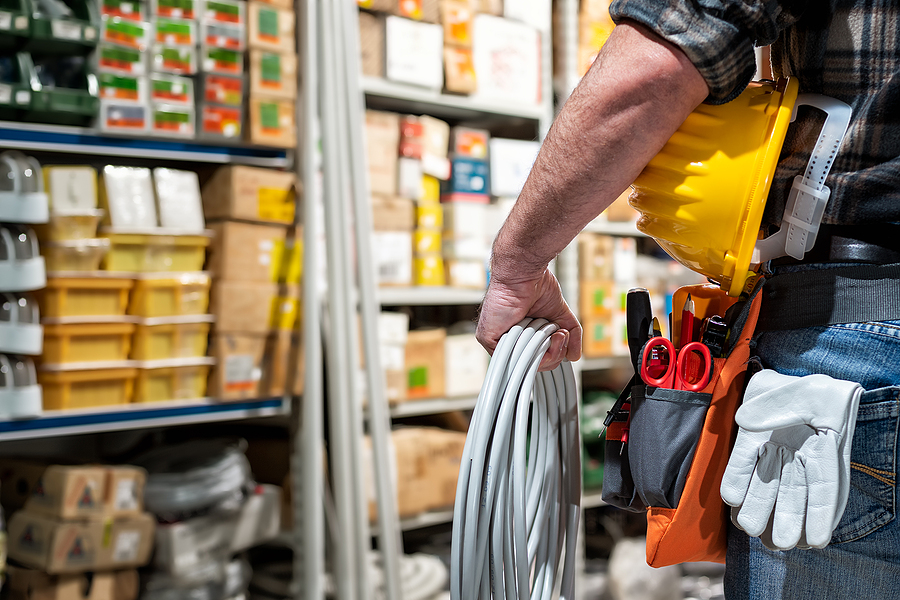 Electrician in an electrical shop getting supplies